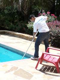 Pool Medic performing pool maintenance services