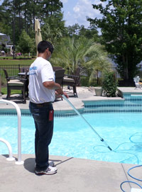 Pool Medic performing pool cleaning services
